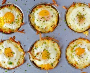 Cheesy Hash Brown Cups with Baked Eggs in a muffin tin