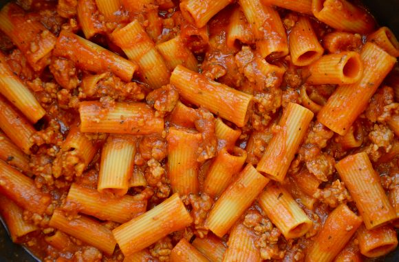 Cooked pasta with Italian sausage in pot