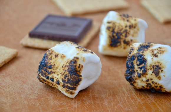 Toasted marshmallows on a cutting board
