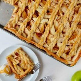 A caramel apple slab pie with a piece cut out