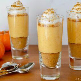 Three individual No-Bake Pumpkin Cheesecake Parfaits