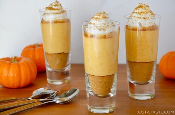 Three individual No-Bake Pumpkin Cheesecake Parfaits