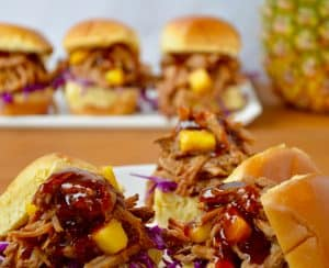Slow Cooker Hawaiian Pulled Pork with purple cabbage on sandwich buns