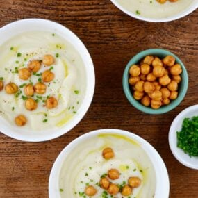 Three bowls with Quick Cauliflower Soup topped with roasted chickpeas