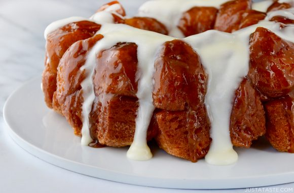 Monkey Bread with Cream Cheese Glaze on white serving plate