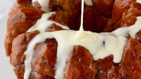 Monkey Bread with Cream Cheese Glaze being poured over top