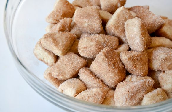 Monkey bread biscuit pieces coated in cinnamon-sugar