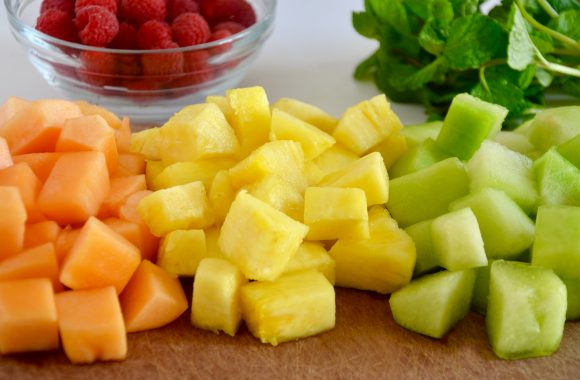 Chopped up fruit on a cutting board