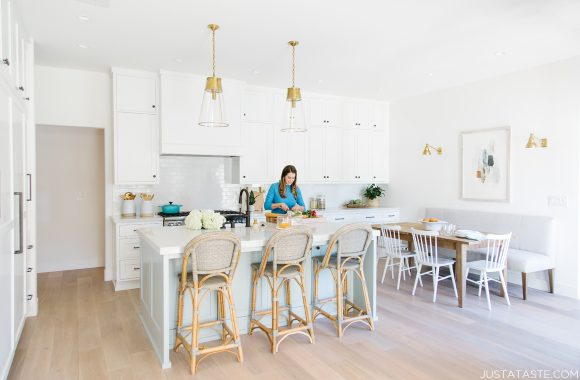 The Just a Taste kitchen remodel with Kelly standing at the kitchen island