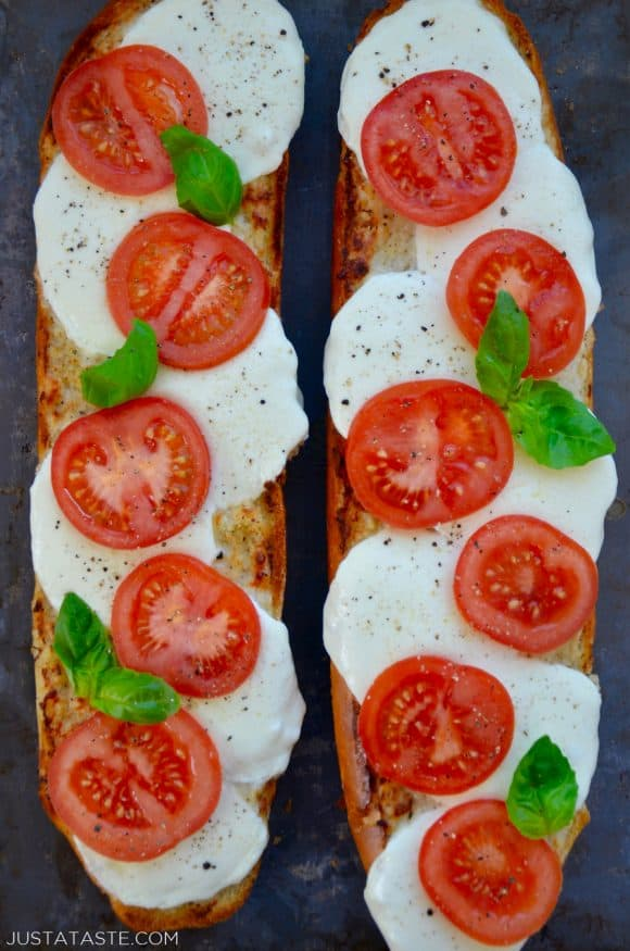 A top down view of two halves of Caprese Garlic Bread
