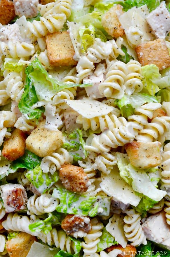 Top down view of Caesar pasta salad with chicken and croutons