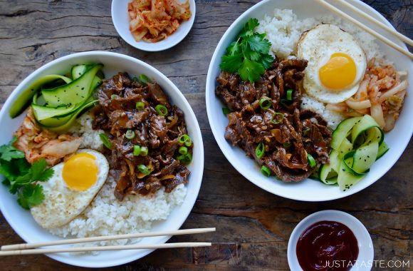 Top down view of Easy Beef Bulgogi Bowls with a fried egg, cucumber ribbons, white rice, fresh cilantro and kimchi