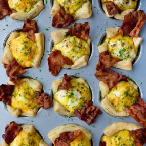 Muffin pan containing Bacon, Egg and Cheese Toast Cups
