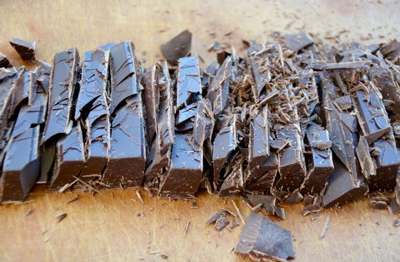 Chopped semisweet chocolate on wood cutting board