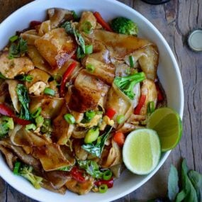 White bowl containing easy homemade drunken noodles with chicken