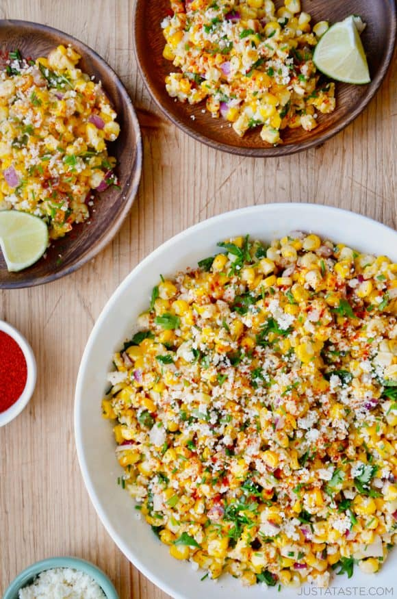 The best Elote Corn Salad topped with fresh herbs and Cotija cheese