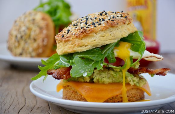 Easy homemade biscuit breakfast sandwich with melted cheddar cheese, bacon, avocado and arugula