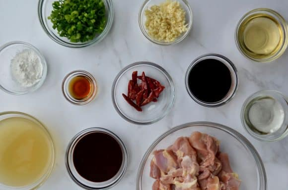 Small and medium glass bowls containing general tso's chicken ingredients