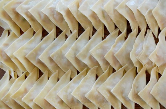 Three rows of triangle-shaped wontons