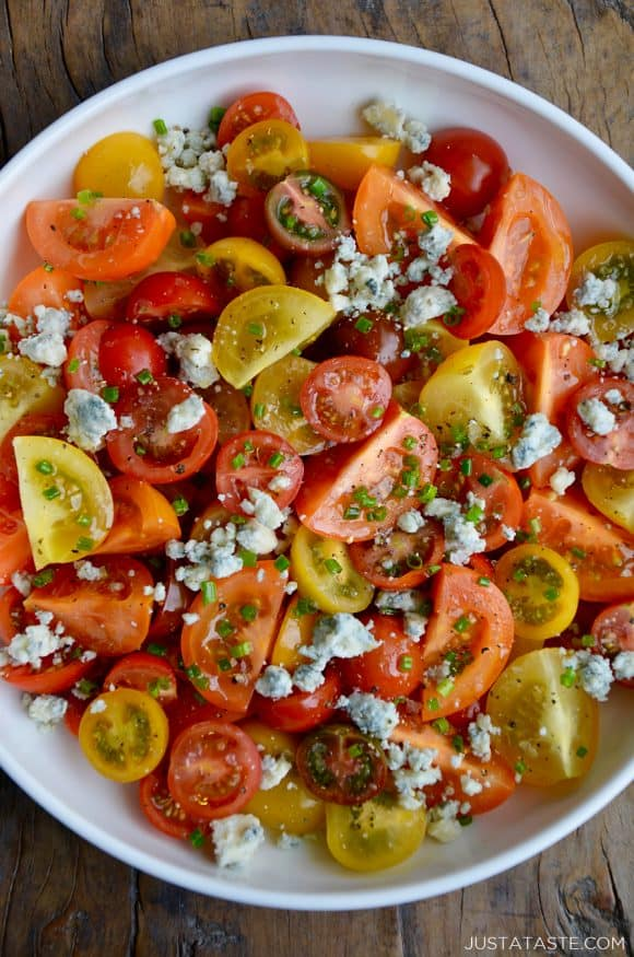 Top down view of Steakhouse Tomato Salad with Blue Cheese and chives