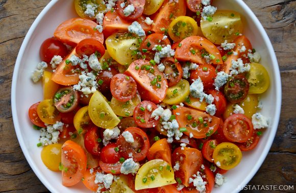 Steakhouse cherry tomato salad with blue cheese on white serving plate