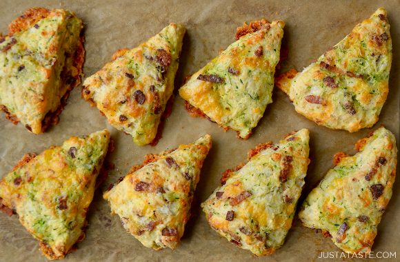 Top down view of the best homemade zucchini bacon cheddar scones on brown parchment paper