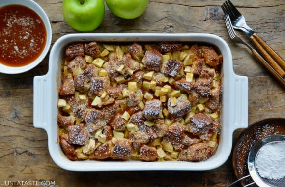 A white baking dish containing Caramel Apple Bread Pudding