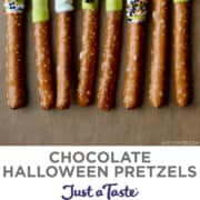 Chocolate Halloween Pretzels decorated with melted chocolate and festive spooky sprinkles.