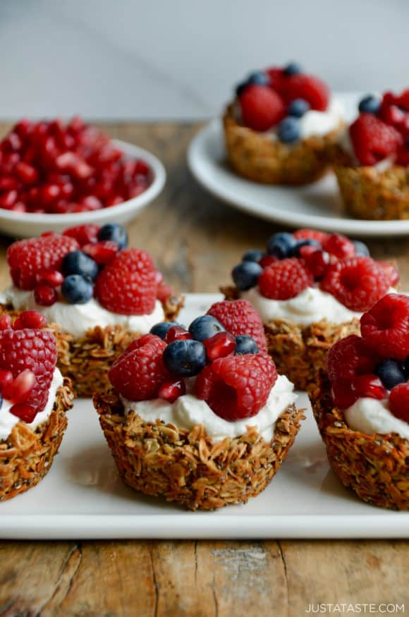 Cups of granola topped with yogurt and fresh fruit