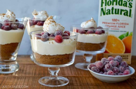 Glass parfait glasses with cheesecake and sugared cranberries