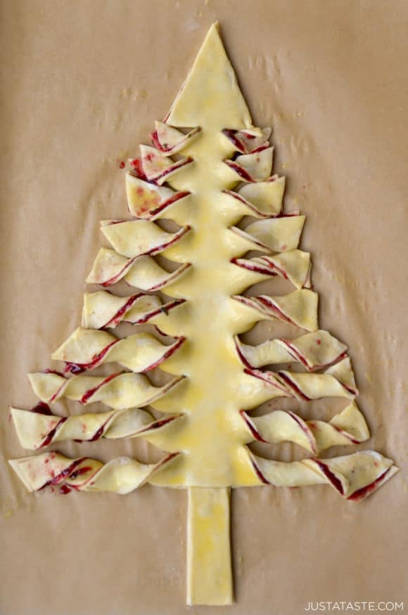 Puff pastry Christmas tree on parchment paper lined baking sheet