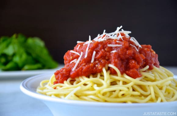 Bowl of spaghetti topped with 10-minute homemade marinara sauce and shredded parmesan cheese