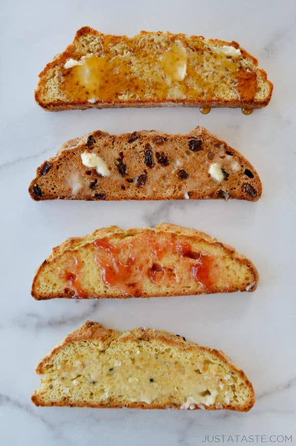 Four slices of bread topped with different toppings