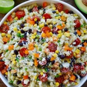 Large bowl containing Southwestern Pasta Salad with Avocado Dressing