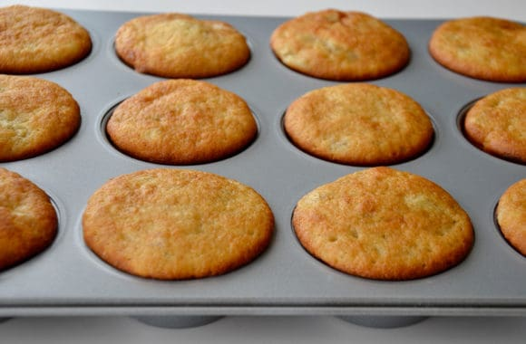 Muffin pan containing freshly baked cupcakes