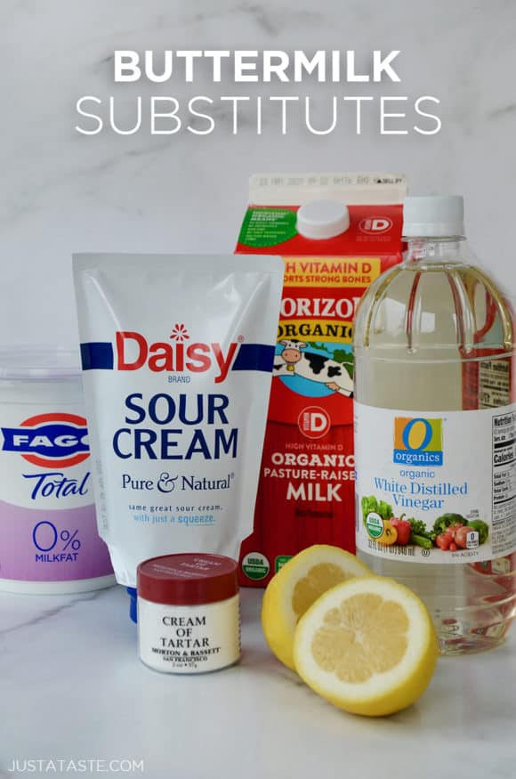 Containers of yogurt, sour cream,, milk and white vinegar as buttermilk substitutes