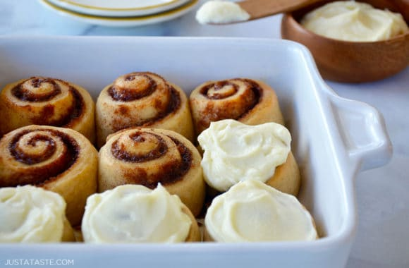 No-yeast cinnamon rolls in a baking dish with half of them frosted