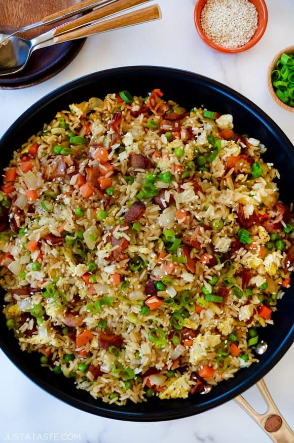 Large skillet containing bacon and egg fried rice