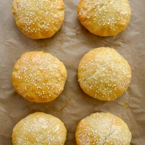 Six Quick Homemade Burger Buns Without Yeast on parchment paper-lined baking sheet