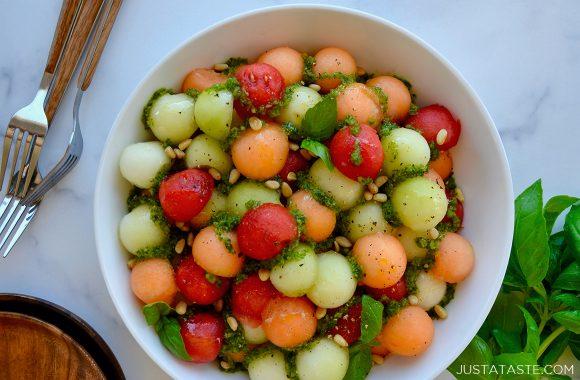 Fresh melon ball salad with pine nuts and basil vinaigrette