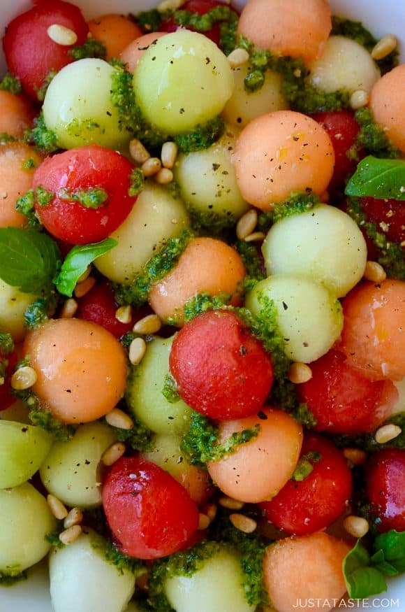 Closeup view of easy melon salad with basil vinaigrette and pine nuts