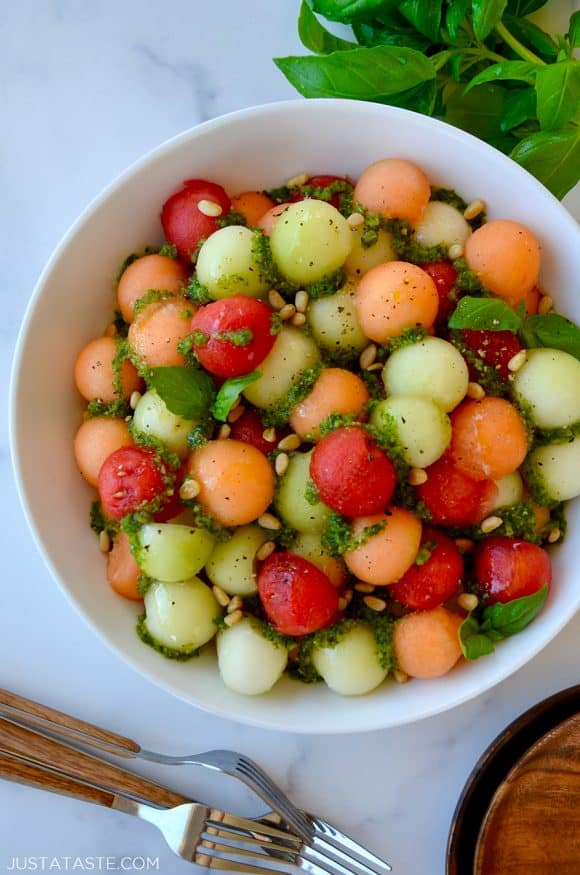 Top down view of white bowl containing easy melon salad with basil vinaigrette