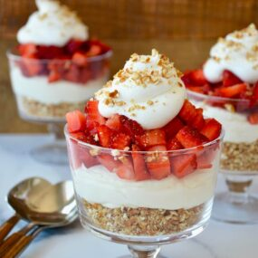 The best Strawberry Pretzel Dessert Cups topped with whipped cream