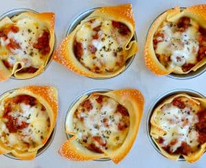 Muffin Tin Lasagna Cups topped with mozzarella cheese