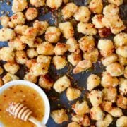 Baked Popcorn Chicken with Honey-Garlic Glaze topped with crushed red pepper flakes