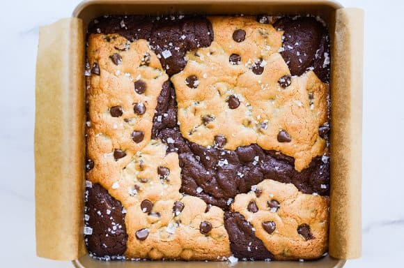 Baked chocolate chip cookie brownie bars in square baking dish