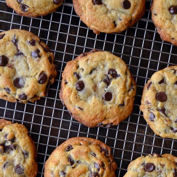 A cooling rack containing chocolate chip cookies