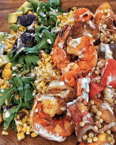 a colorful salad with shrimp