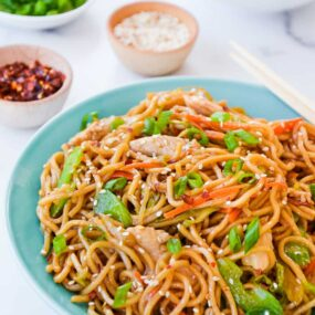 Quick Chicken Chow Mein in blue serving bowl with chopsticks