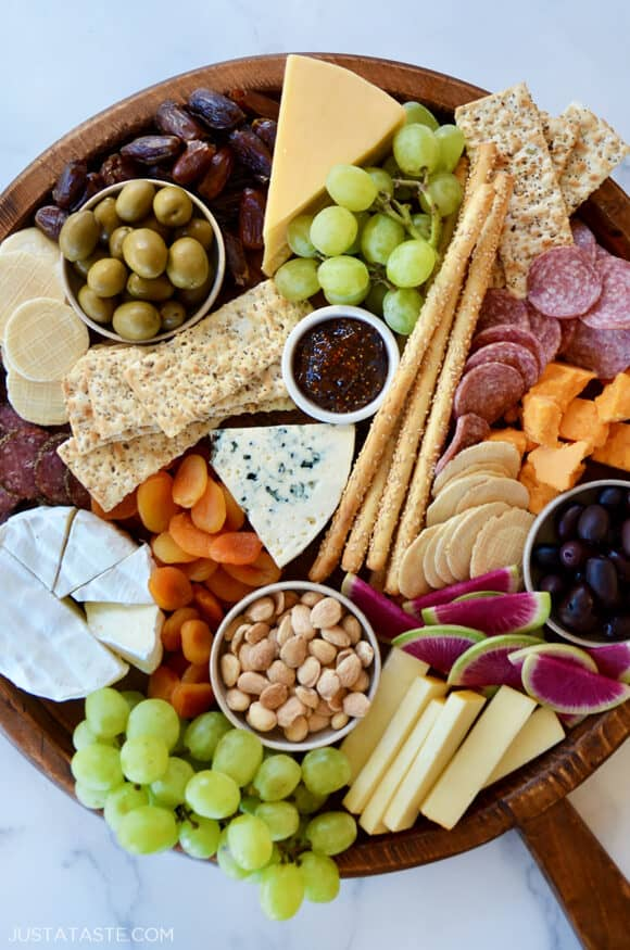 A top down view of the best charcuterie board with cheese, meat and fruit